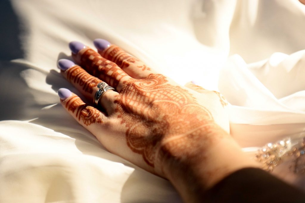 bridal henna, bride with purple nails