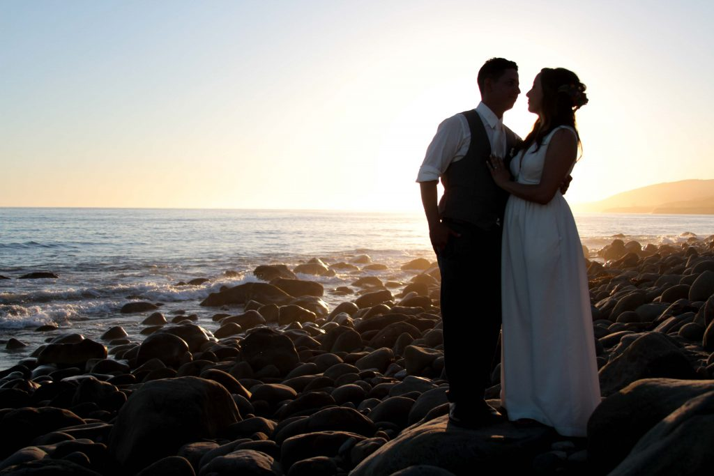Bride and Groom in silhouette on the beach